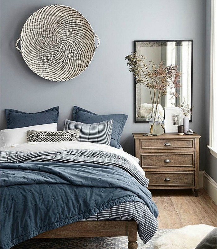 Not sure what to hang over your bed? A large, shallow woven basket is a simple, beautiful idea!
