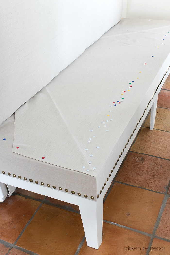 Adding brass nailheads to kitchen bench seat
