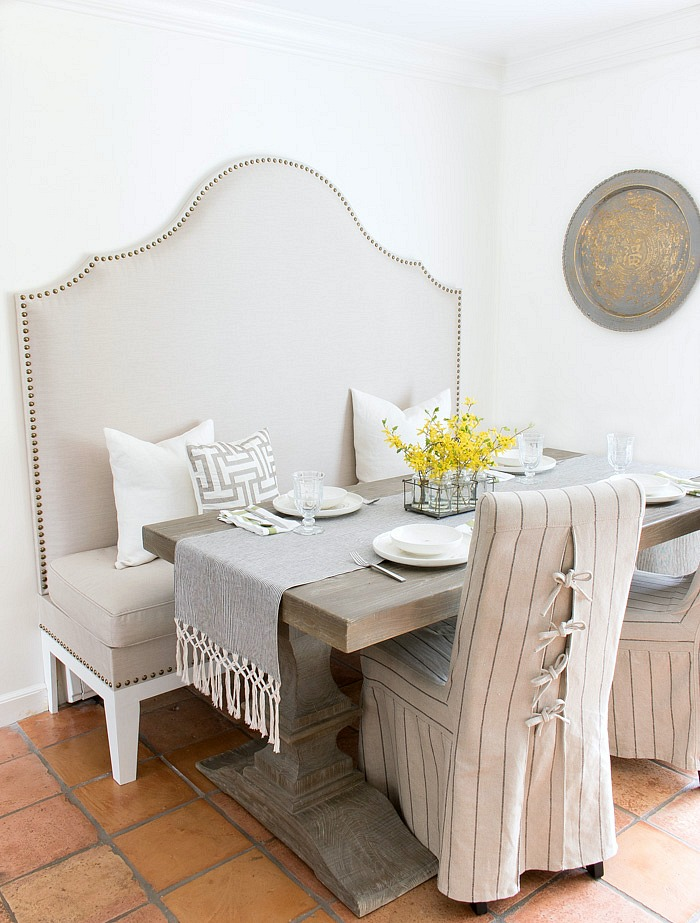 DIY tutorial for how to make an upholstered kitchen banquette that looks like a custom piece!