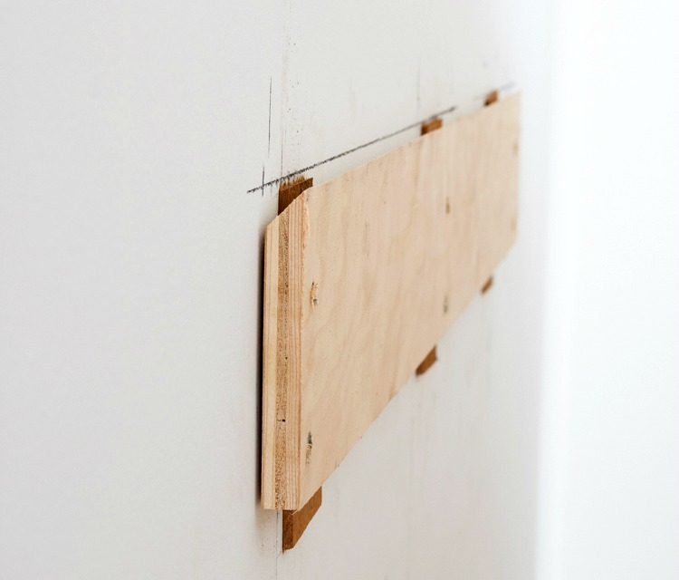 Wood cleat for hanging headboard on the wall