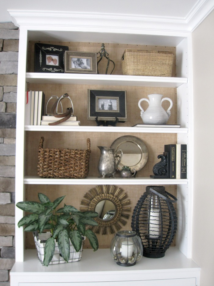 Add burlap to the back of a bookcase to add texture and interest!