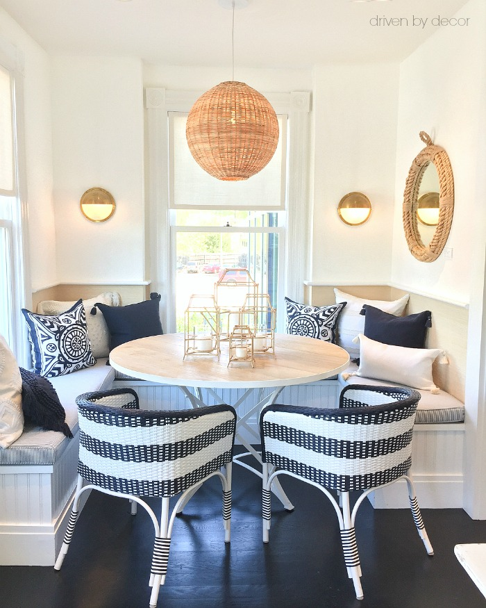 Woven lighting and accents warm up this kitchen banquette dining nook!