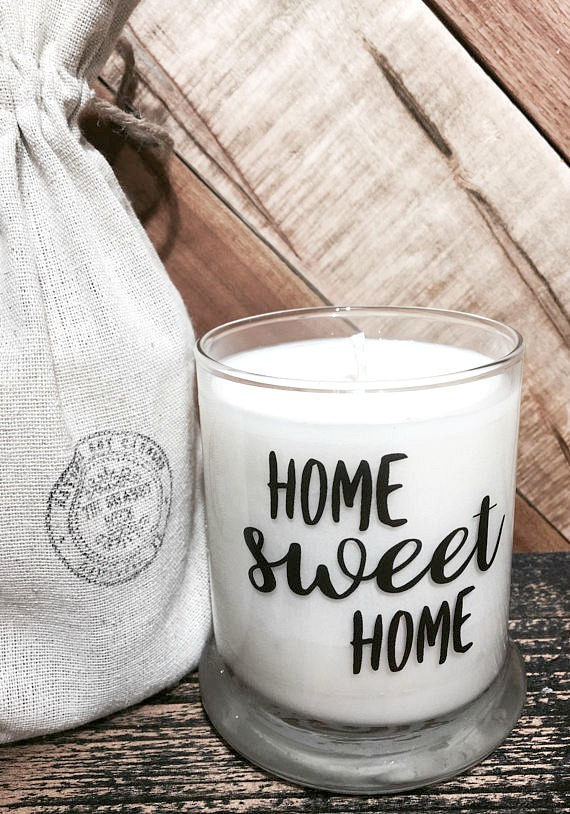 The perfect hostess gift! A personalized candle wrapped in a linen gift bag