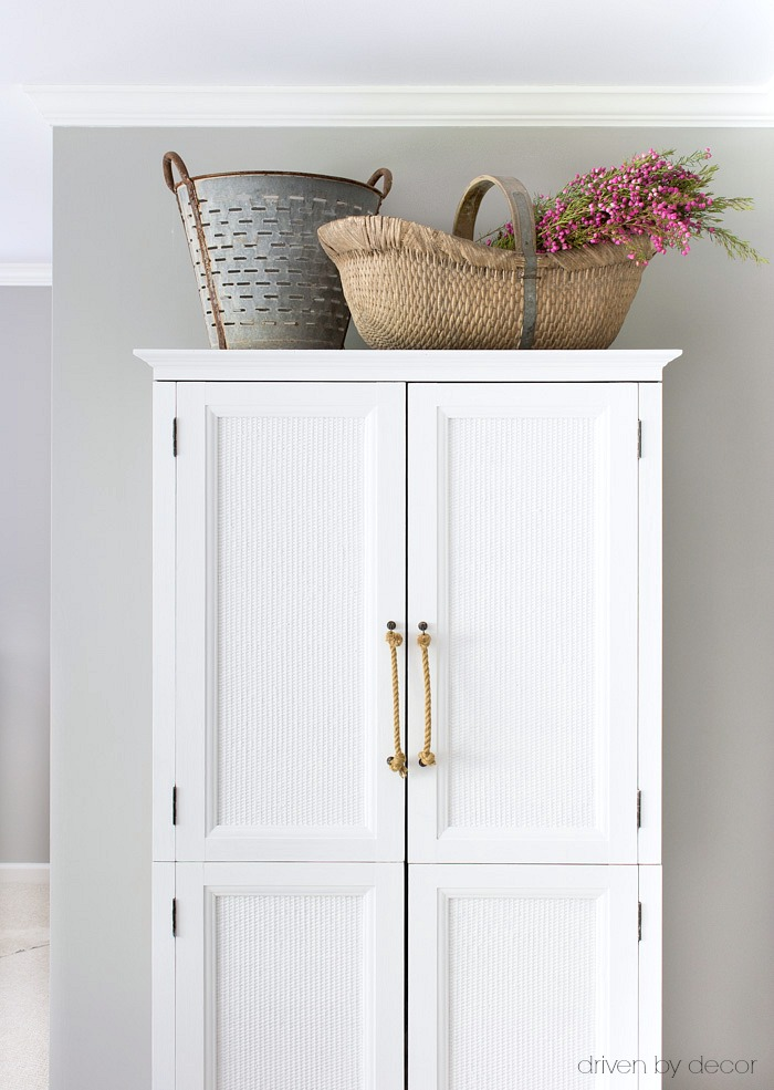 Guest room armoire that's perfect for stashing extra pillows and blankets