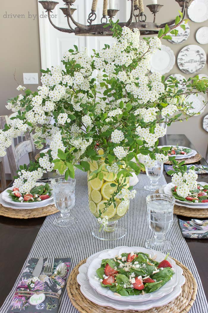 Create a simple centerpiece with flowering branches and a lemon filled vase - this post has a great tip for the easy way to do it!