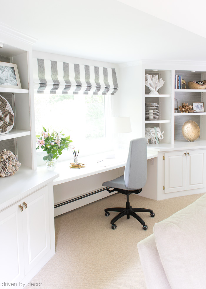 Home office desk between bookcases in family room
