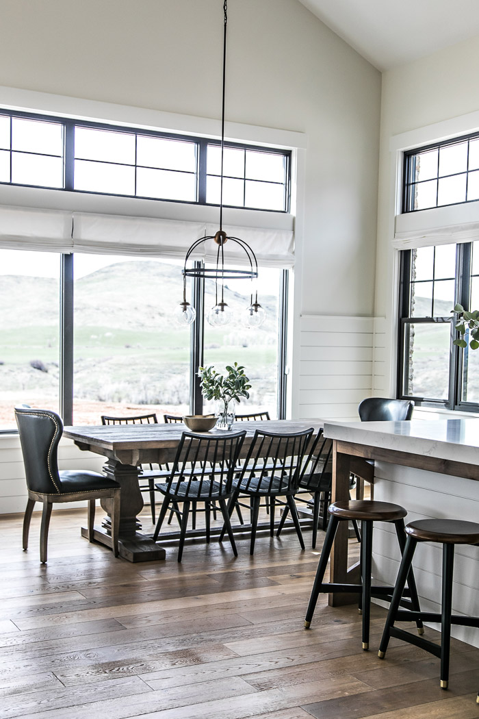 Eat-in dining area in modern farmhouse kitchen with pedestal table and black spindle chairs - Sita Montgomery Interiors