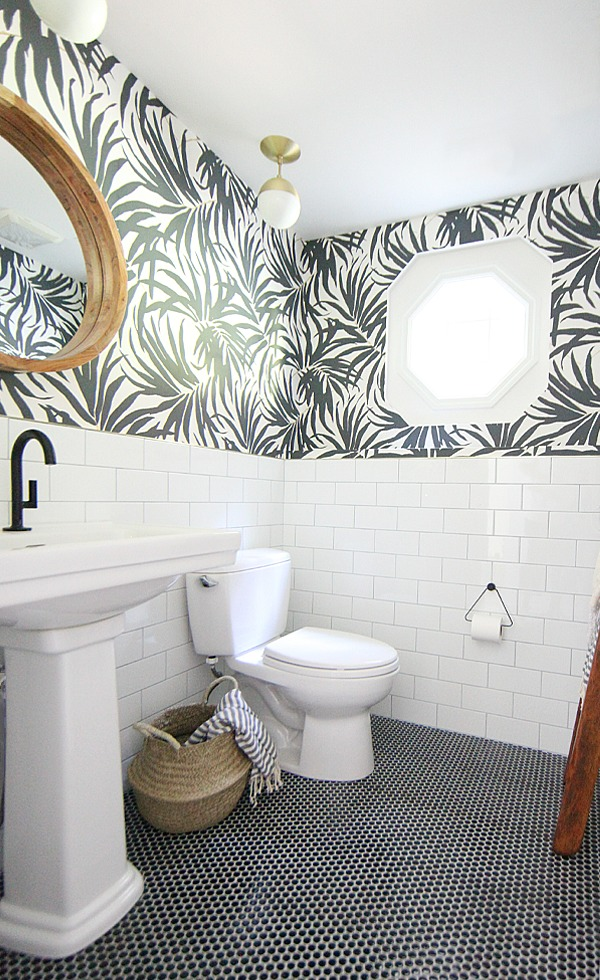 Gorgeous bathroom remodel with tile on the bottom half of the walls and wallpaper on the top! by House of Hipsters