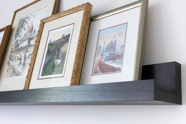 Black ledge shelf for art so that you can easily swap it in and out! Link to ledge shelf in post!