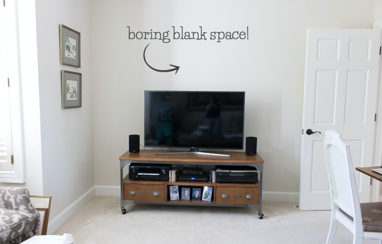 "Pic of blank space above the TV before we decorated it! Click over for the ""after""!"