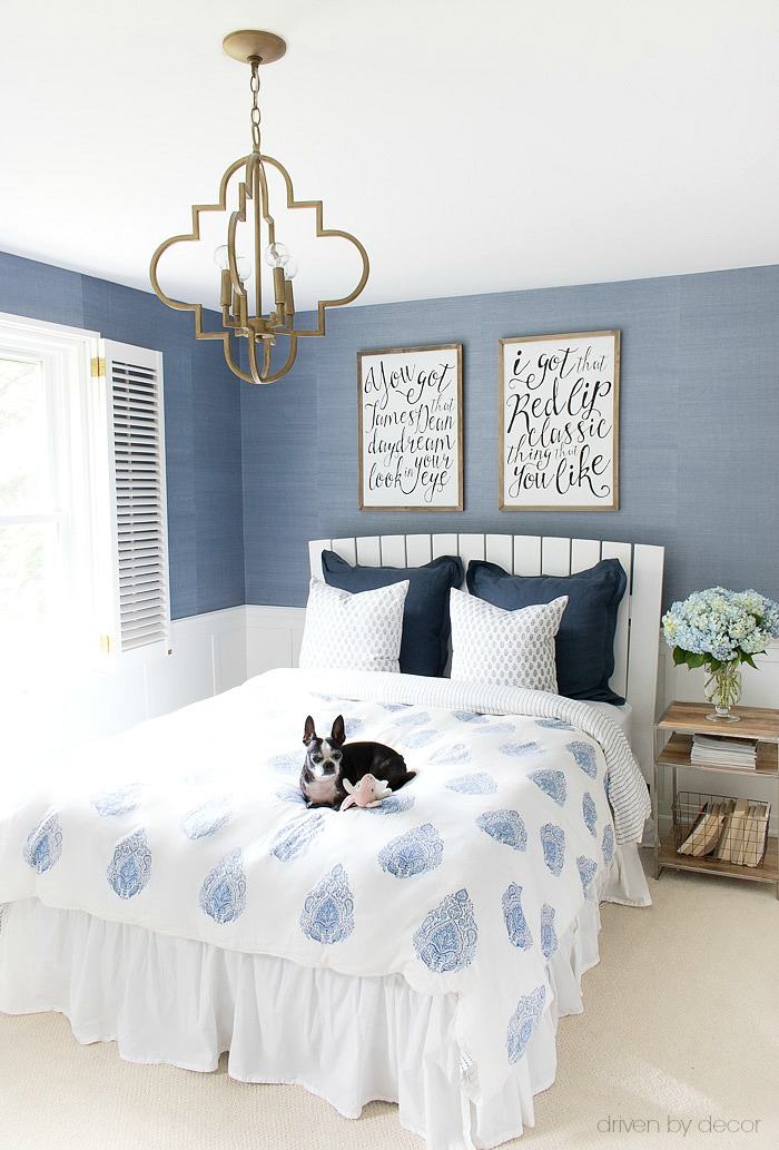 Blue and white bedroom decorated with a vase of hydrangeas for summer