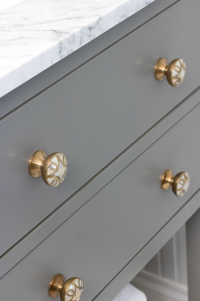 A great way to dress up a bathroom vanity is by simply switching out the knobs! Love these brass and mother of pearl beauties!