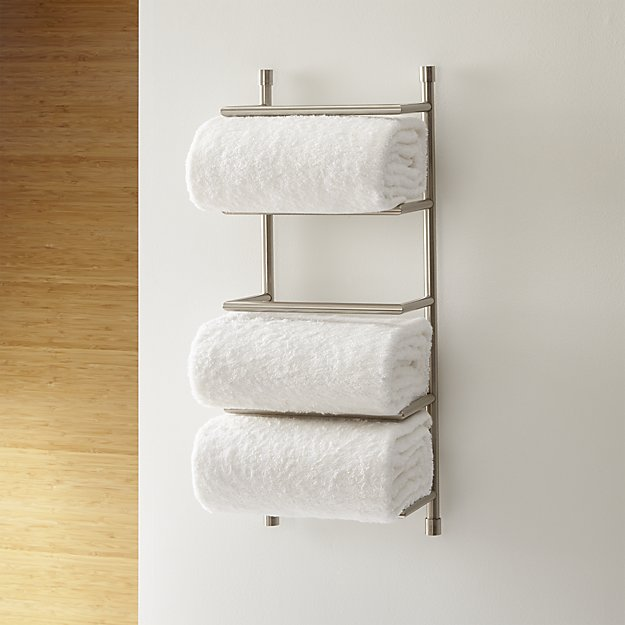 No storage space for towels in your bathroom? A wall-mounted towel rack like this one can be a life saver!