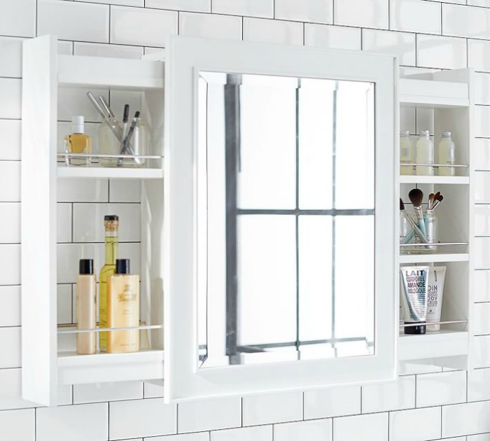 Love this twist to a typical medicine cabinet - pull out shelves on the sides!