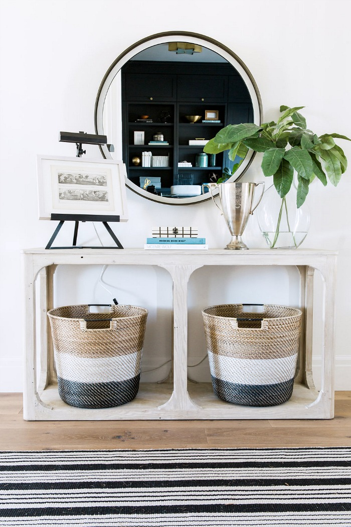 Foyer console with open bottom for baskets storing shoes - so smart!
