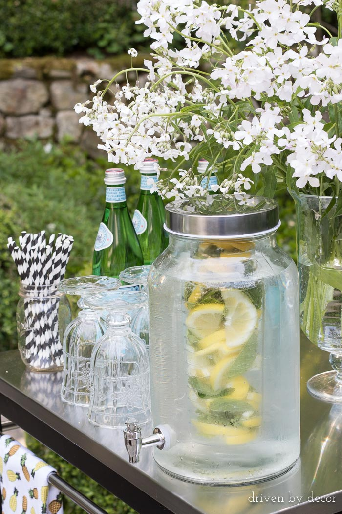 A glass drink dispenser with an infuser for fruit is perfect for summer entertaining!