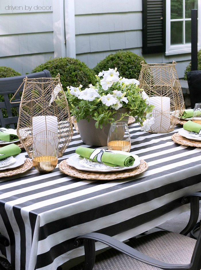 A pair of gold wire hangers flanking a flower-filled planter is the perfect simple outdoor table centerpiece