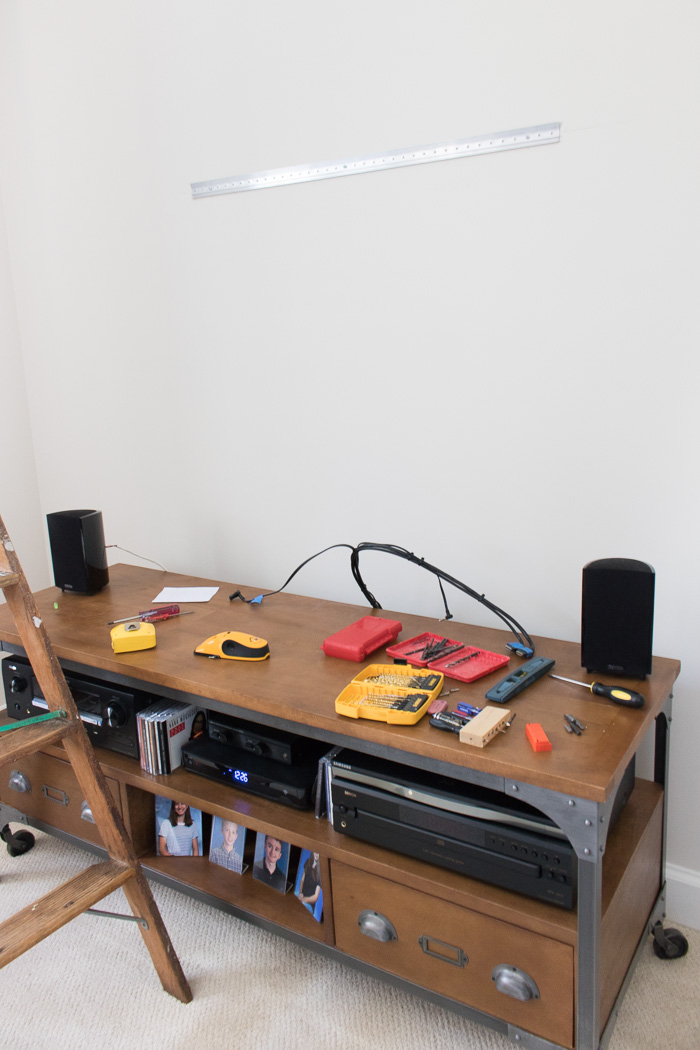Hanging an art ledge shelf above a TV and media console