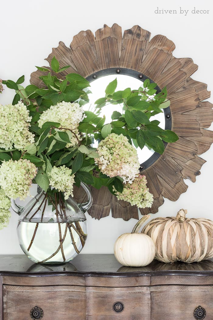 Love this oversized glass jug vase filled with hydrangeas!