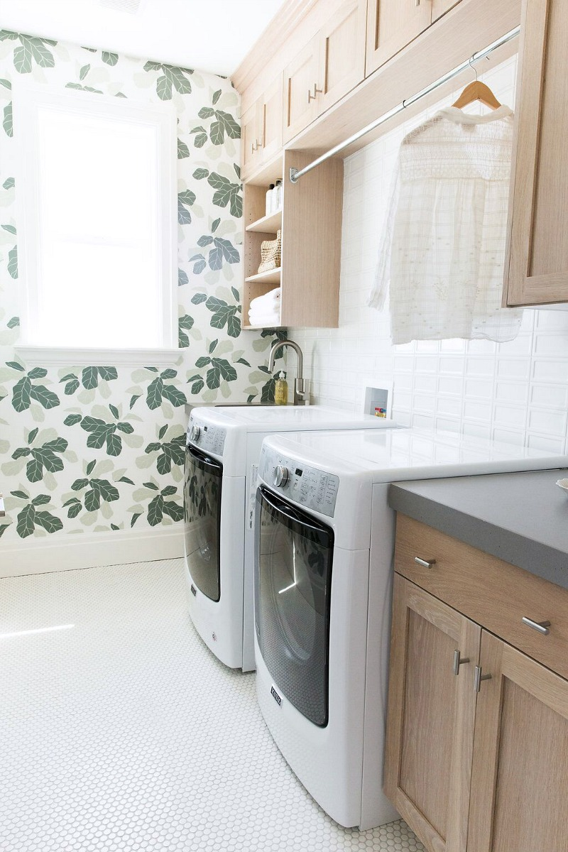 Love both the design and function of this laundry room - I need that hanging rack over the washer and dryer!