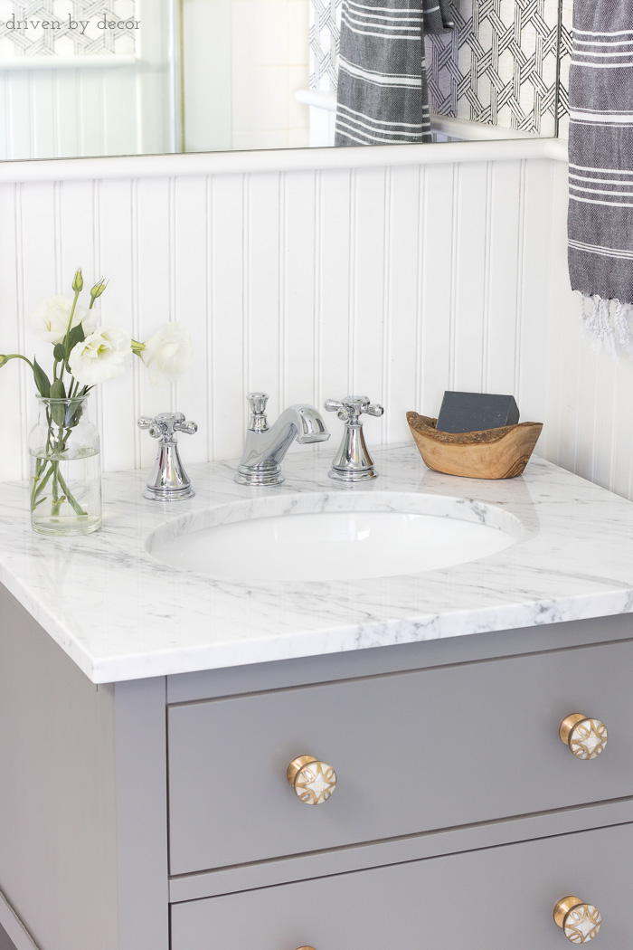Gray vanity with marble vanity top and Delta Cassidy chrome faucet - love the combination!
