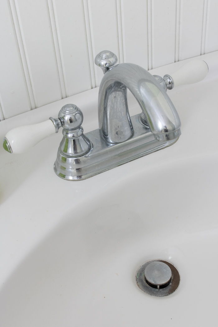 "The ""before"": Our old ugly faucet and rusted drain - click through for the ""after""!"