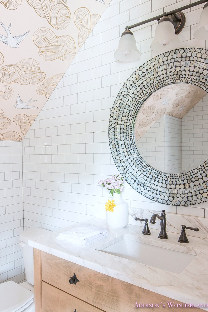 Such a beautiful round inlay mirror over this vanity from the home of Brittany Hayes!