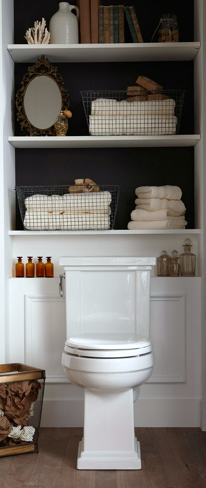 Adding built-in or freestanding shelving behind the toilet is a great way to add some extra storage in a small bathroom!