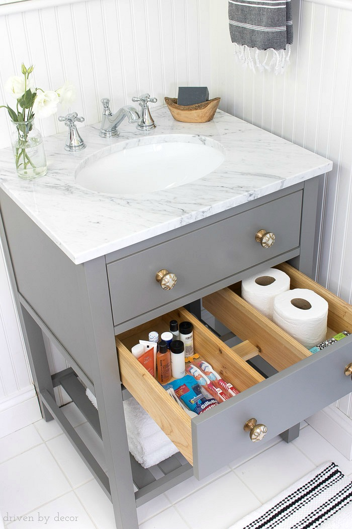 A pull-out storage drawer in this small vanity is perfect for storing toiletries and extra rolls of TP!
