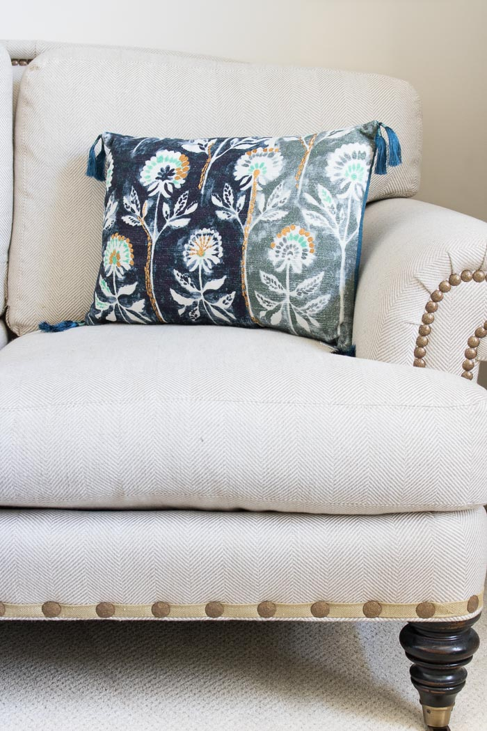 Super cute watercolor floral pillow with tassel trim!