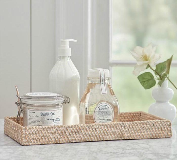 This woven tray is the perfect size to sit on your toilet tank and hold a few bathroom accessories!