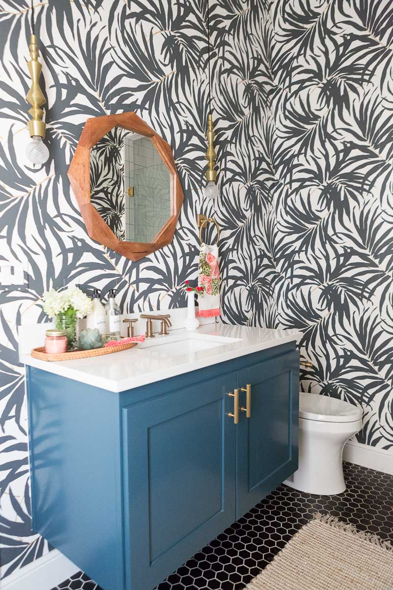 Love the black and white palm frond wallpaper in this gorgeous bathroom by CC + Mike