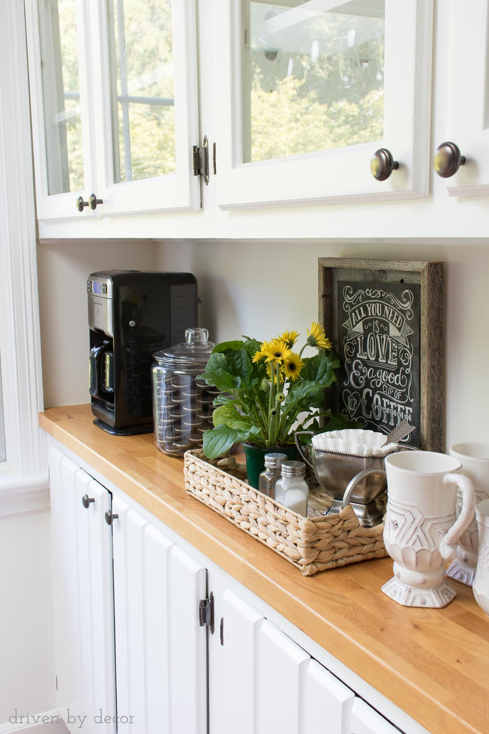 Butcher block countertops sealed with waterlox to create a cute kitchen coffee station