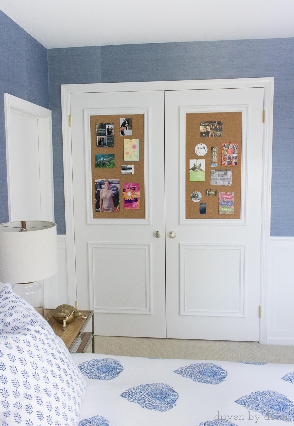 Molding and cork added to flat closet doors to create framed bulletin boards!