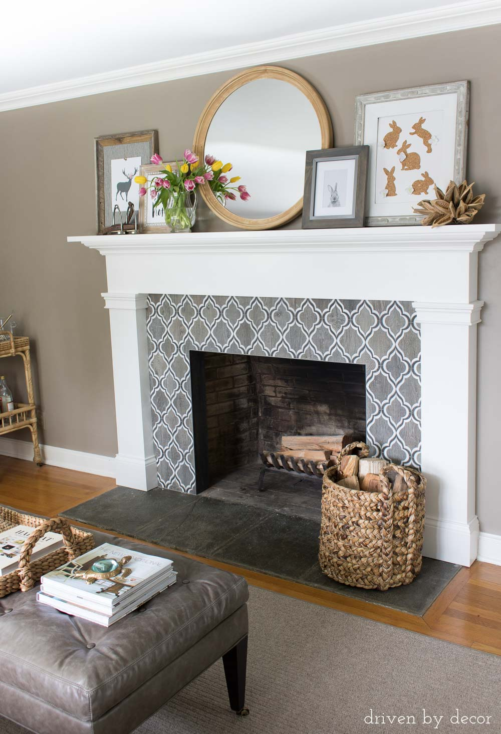 Love the patterned tile fireplace surround and layered mantel art!