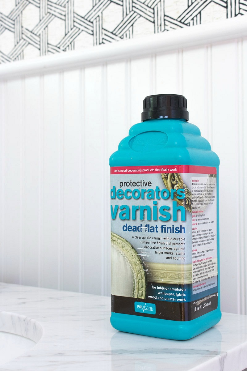 The secret weapon to making wallpaper work in bathrooms is this flat finish varnish sealer! More details in the post!