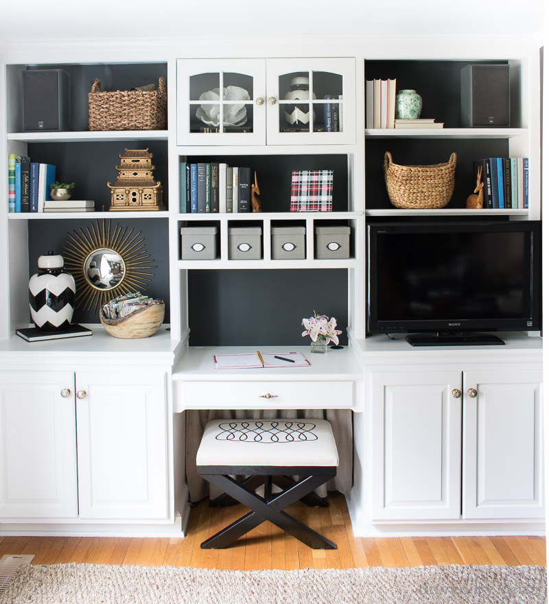 Back of bookcases painted black - makes accessories stand out and TV blend in!