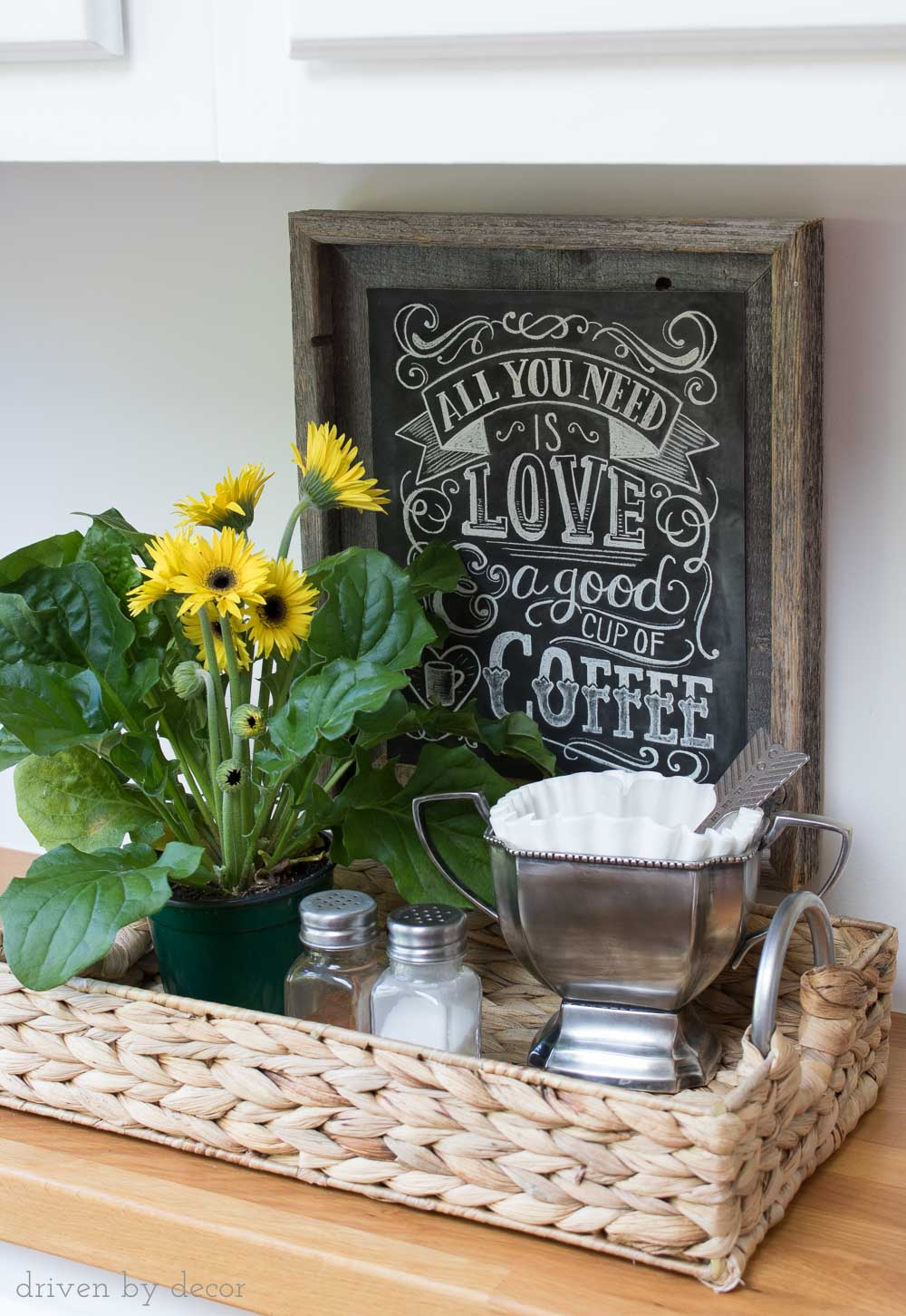 Simple coffee station in woven tray - coffee filters held in trophy cup (love the heart coffee scoop!) and cute chalkboard coffee print!
