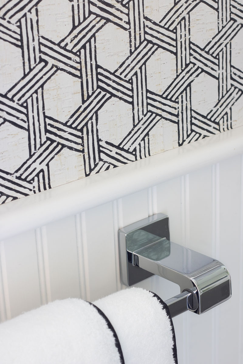 Love this black and white textured cork wallpaper! Great tips in this post about hanging wallpaper in bathroom and how to make it work!