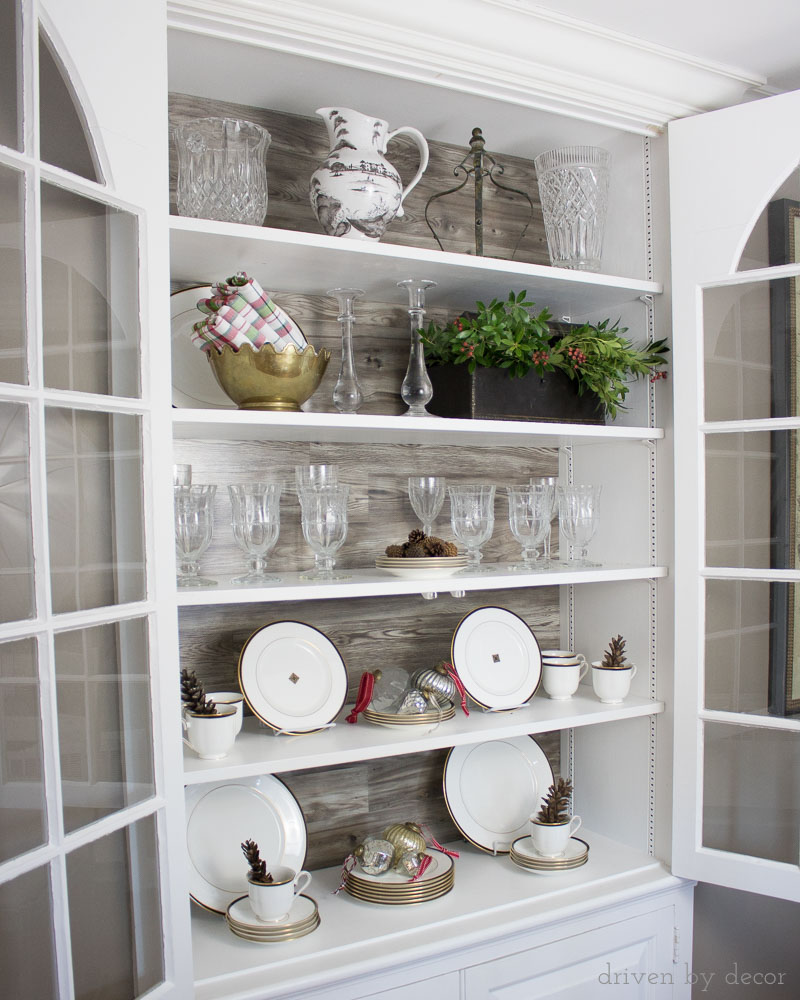 Love this idea for dressing up the back of a cabinet! Use wood planks - either real wood or faux like the Pergo used in this project!