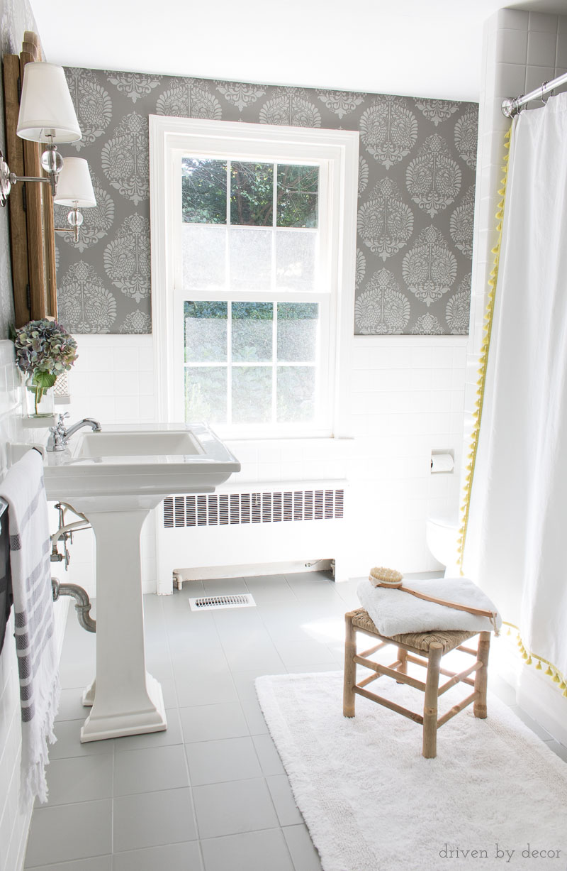 A Budget Bathroom Remodel With Ceramic Tile Floors Painted Gray And Walls Stenciled To Look Like