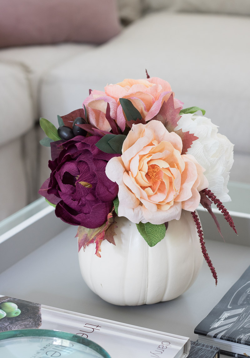 Can you believe these are paper flowers?! The perfect lasts-forever bouquet in a pumpkin vase for fall!