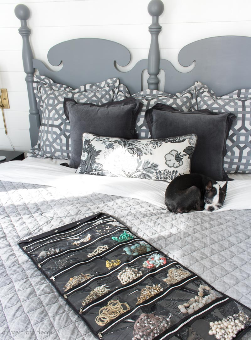 A hanging jewelry organizer that you can fold up and put in your suitcase for travel!