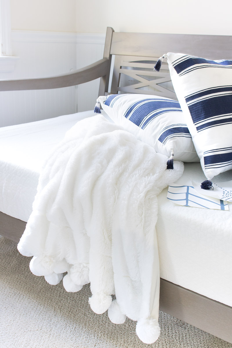 The coziest fleece pom pom throw!