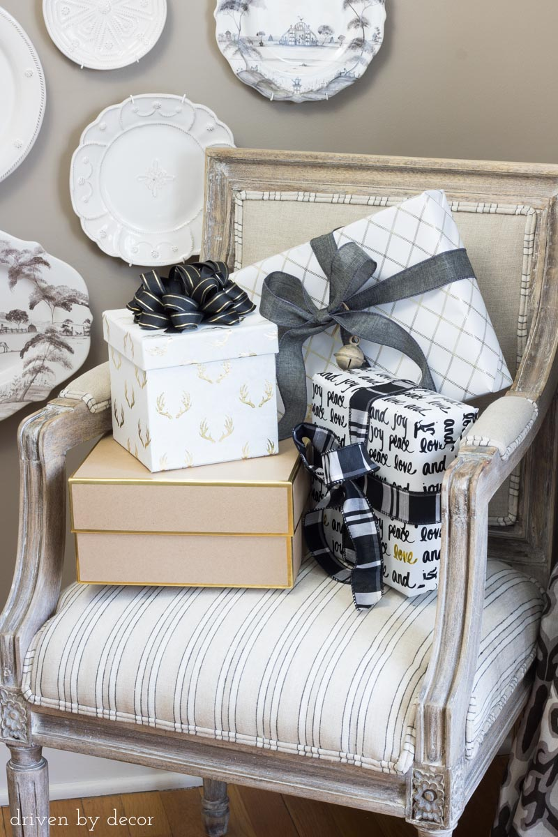 Love the idea of using wrapped presents to decorate your home for the holidays! One of the great stress free holiday tips in this post!