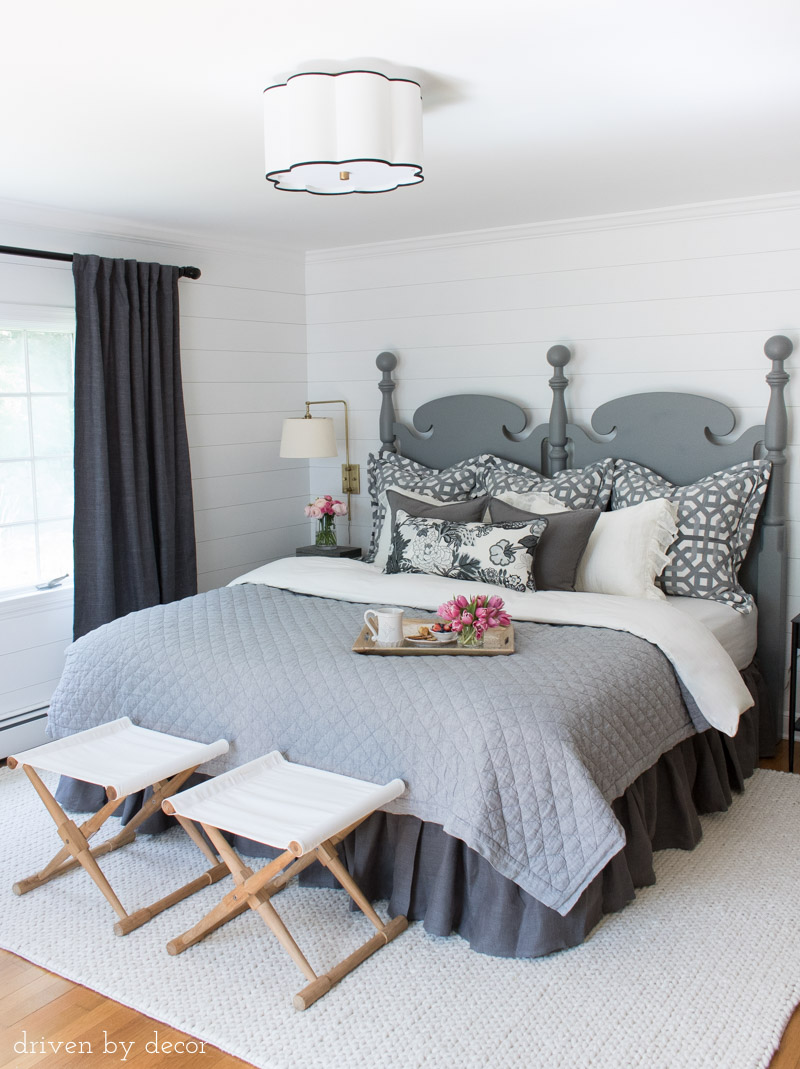 One of my favorite before and after makeovers! We added shiplap to the walls, installed new light fixtures, revamped a Craigslist headboard, and added new bedding to totally transform our space!