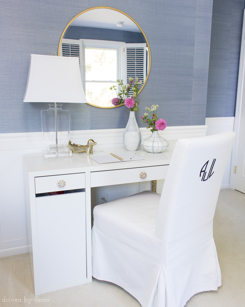 Take an inexpensive slipcovered IKEA chair and add a monogram to the back of it - LOVE this idea! Lots of other clever ideas for decorating kids rooms in this post!