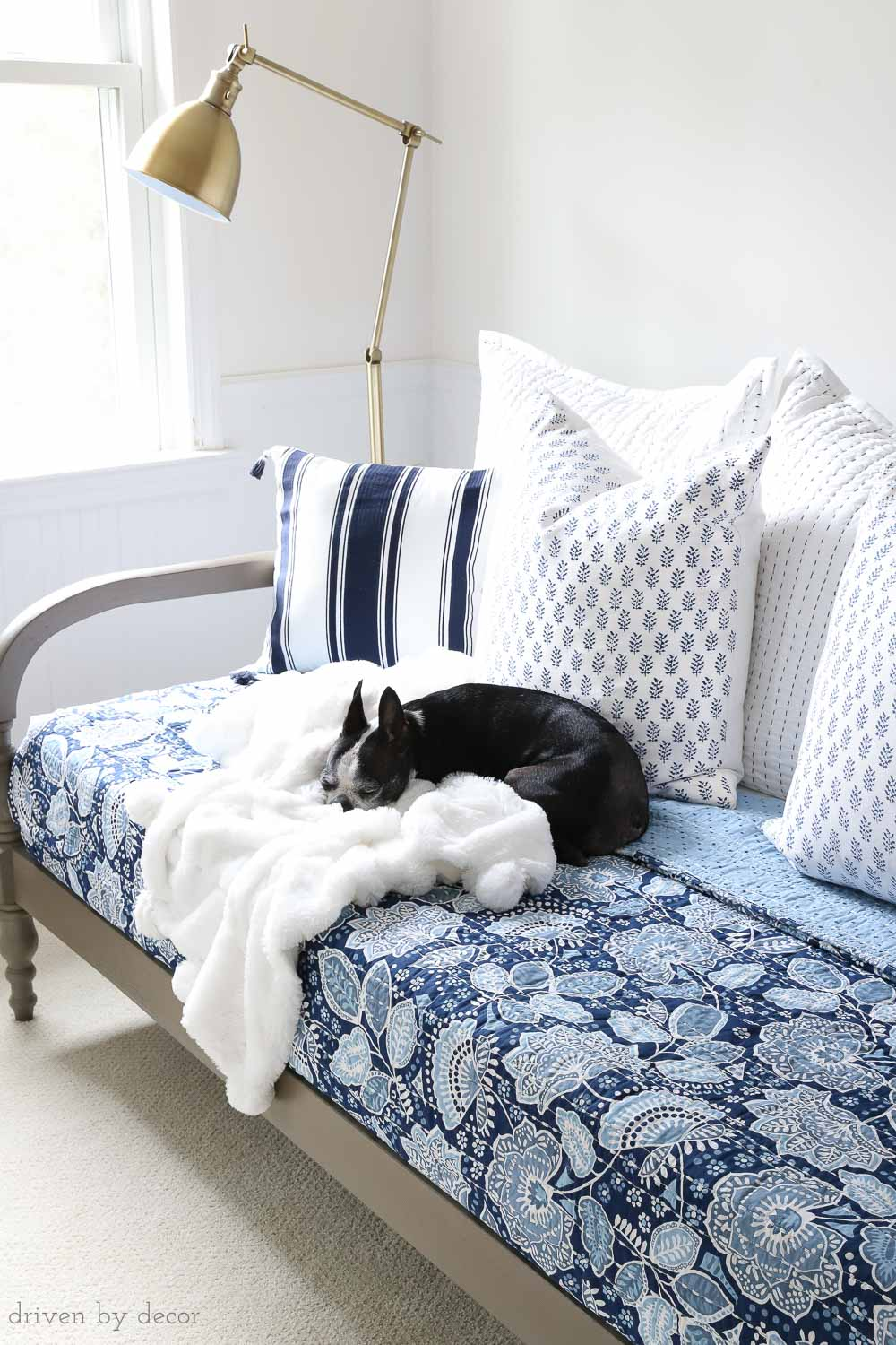 Great tips on where to start when decorating your bedroom. Love the combination of this colorful Vera Bradley bedding with the warm wood daybed and brass floor lamp!