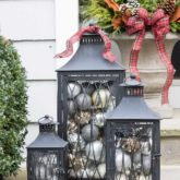Love the idea of filing lanterns with ornaments to decorate your porch for Christmas!