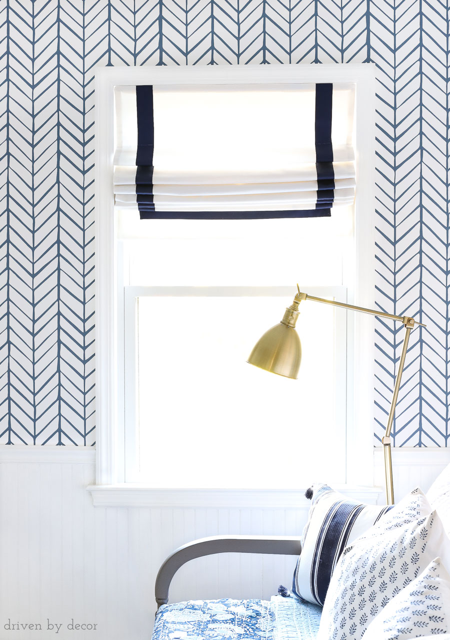 Gorgeous custom Roman shades with navy ribbon trim for the same price as non-custom shades at a big box store! Source linked in post!